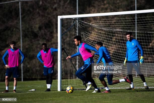 Mousa Dembele of Tottenham Hotspur conducts the ball under pressure from Kyle WalkerPeters during a training session during day three of the...