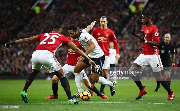 Mousa Dembele of Tottenham Hotspur controls the ball under pressure of Antonio Valencia Ander Herrera Zlatan Ibrahimovic and Paul Pogba of Manchester...
