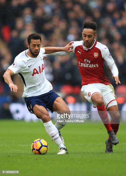 Mousa Dembele of Tottenham Hotspur in action with PierreEmerick Aubameyang of Arsenal during the Premier League match between Tottenham Hotspur and...