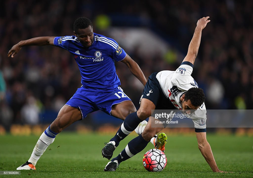 Mousa Dembele of Tottenham Hotspur is brought down by John Mikel Obi of Chelsea during the Barclays Premier League match between Chelsea and Tottenham Hotspur at Stamford Bridge on May 02, 2016 in London, England.jd
