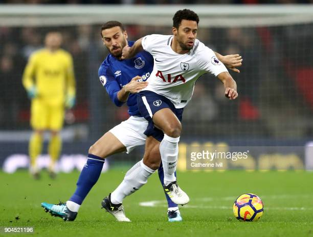 Mousa Dembele of Tottenham Hotspur is challenged by Cenk Tosun of Everton during the Premier League match between Tottenham Hotspur and Everton at...
