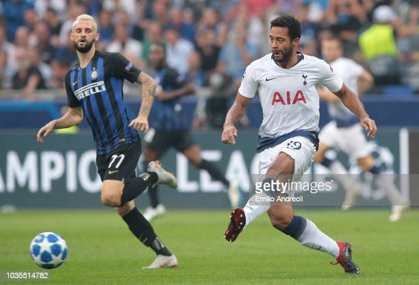 Mousa Dembele of Tottenham Hotspur is challenged by Marcelo Brozovic of FC Internazionale during the Group B match of the UEFA Champions League...
