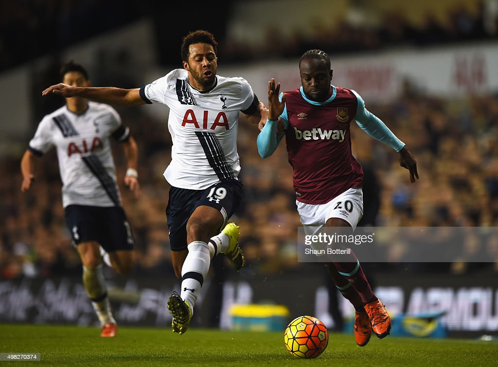 Mousa Dembele of Tottenham Hotspur is challenged by Victor Moses of West Ham United during the Barclays Premier League match between Tottenham Hotspur and West Ham United at White Hart Lane on November 22, 2015 in London, England.