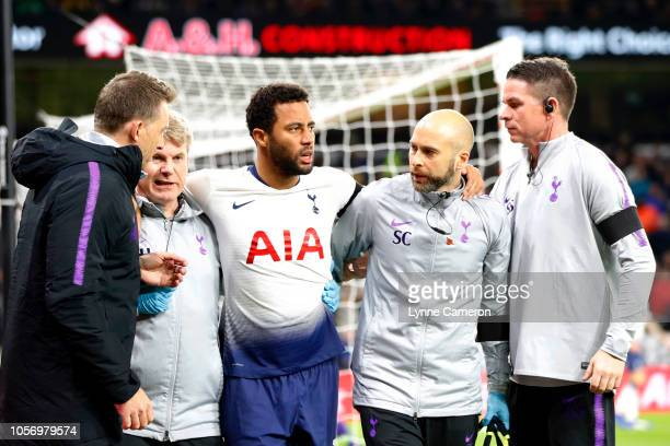 Mousa Dembele of Tottenham Hotspur is led off the pitch injured during the Premier League match between Wolverhampton Wanderers and Tottenham Hotspur...
