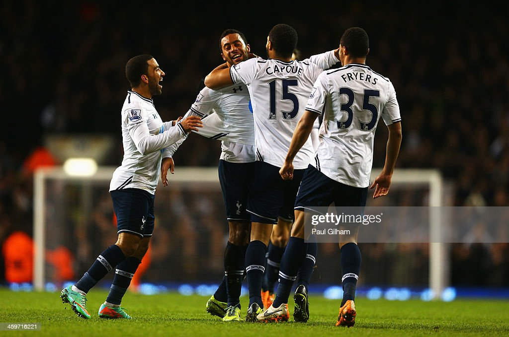 Mousa Dembele (2ndL) of Tottenham Hotspur is mobbed by team mates after scoring his team's second goal during the Barclays Premier League match between Tottenham Hotspur and Stoke City at White Hart Lane on December 29, 2013 in London, England.