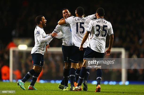 Mousa Dembele of Tottenham Hotspur is mobbed by team mates after scoring his team's second goal during the Barclays Premier League match between...
