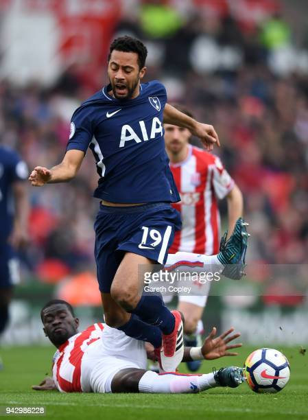 Mousa Dembele of Tottenham Hotspur is tackled by Badou Ndiaye of Stoke City during the Premier League match between Stoke City and Tottenham Hotspur...