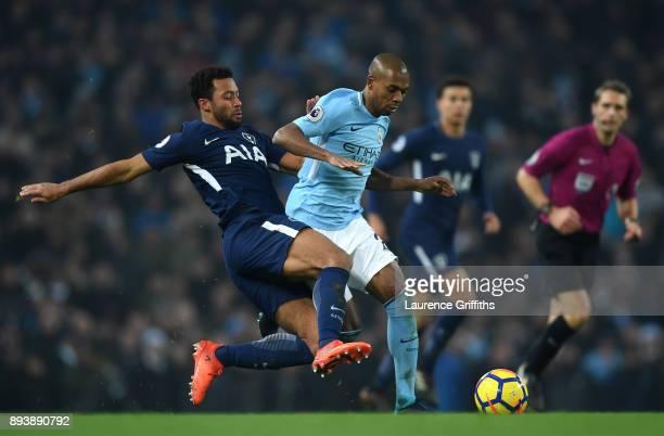 Mousa Dembele of Tottenham Hotspur tackles Fernandinho of Manchester City during the Premier League match between Manchester City and Tottenham...