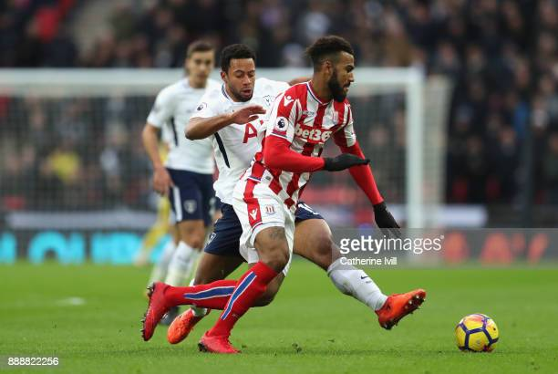 Mousa Dembele of Tottenham Hotspur tackles Maxim ChoupoMoting of Stoke City during the Premier League match between Tottenham Hotspur and Stoke City...