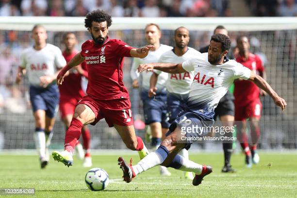 Mousa Dembele of Tottenham stretches to tackle Mohamed Salah of Liverpool during the Premier League match between Tottenham Hotspur and Liverpool FC...