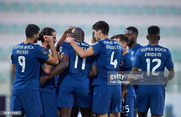 Mousa Marega of FC Porto celebrates his first goal with team mates during the Liga NOS match between Portimonense SC and FC Porto at Estadio...