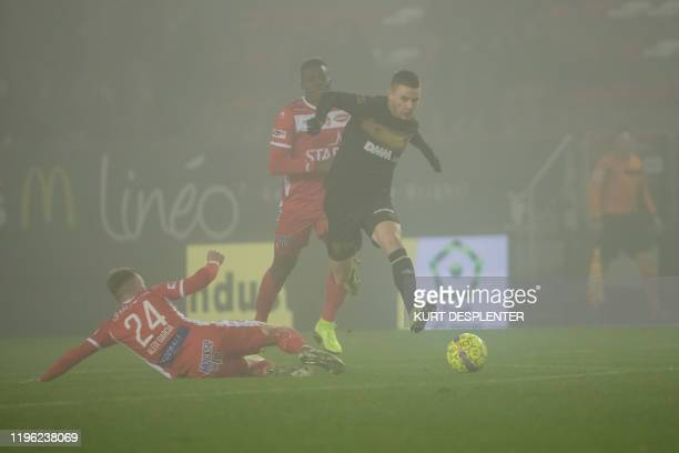 Mouscron's Aleix Garcia and STVV's Wolke Janssens fight for the ball during a soccer match between RE Mouscron and STVV SintTruiden Saturday 25...