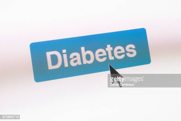 Mouse arrow clicking on DIABETES button on computer screen