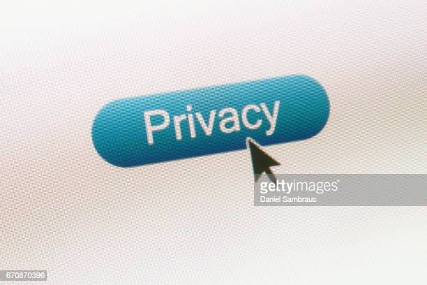 mouse arrow clicking on privacy button on computer screen - home icon stock photos and pictures
