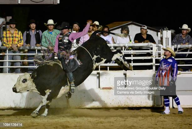 Mouse Hampton hangs on for a winning score of 78 points during the bull riding event, Sunday, Aug. 4 at the Boulder County Fair in Longmont. The CPRA...
