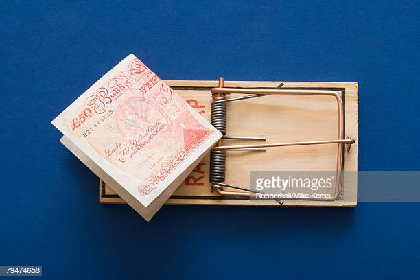 Mouse trap with money as bait