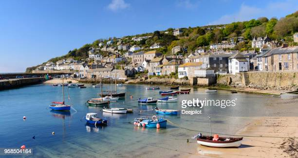 mousehole fishing village near penzance in cornwall, england - coastline stock photos and pictures