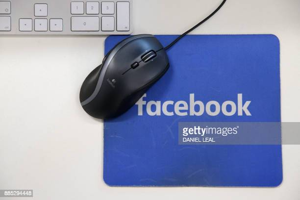 A mousepad with the Facebook logo is seen at Facebook's new headquarters designed by Canadianborn American architect Frank Gehry at Rathbone Place in...