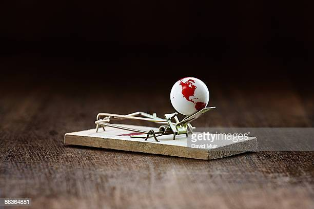 mousetrap with world globe