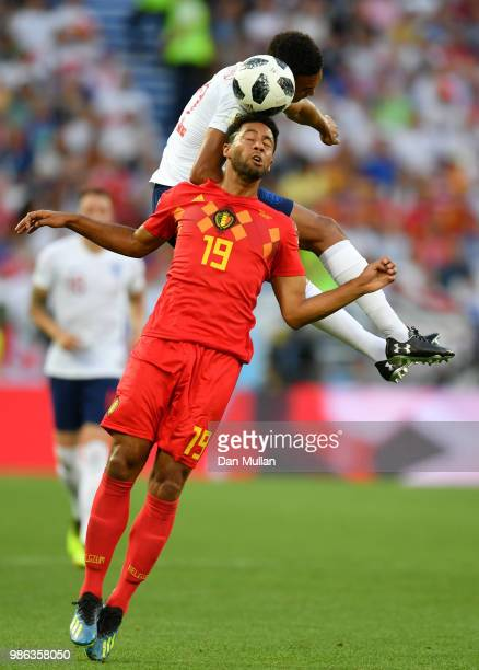 Moussa Dembele of Belgium competes for a header with Trent AlexanderArnold of England during the 2018 FIFA World Cup Russia group G match between...