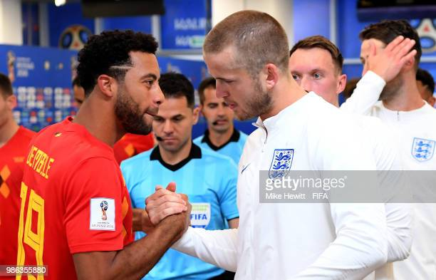 Moussa Dembele of Belgium greets club teammate Eric Dier of England in the tunnel prior to the 2018 FIFA World Cup Russia group G match between...