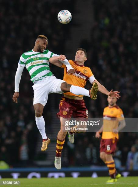 Moussa Dembele of Celtic and Carl McHugh of Motherwell challenge for the ball during the Betfred League Cup Final between Celtic and Motherwell at...
