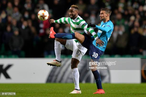 Moussa Dembele of Celtic and Emanuel Mammana of Zenit St Petersburg during UEFA Europa League Round of 32 match between Celtic and Zenit St...