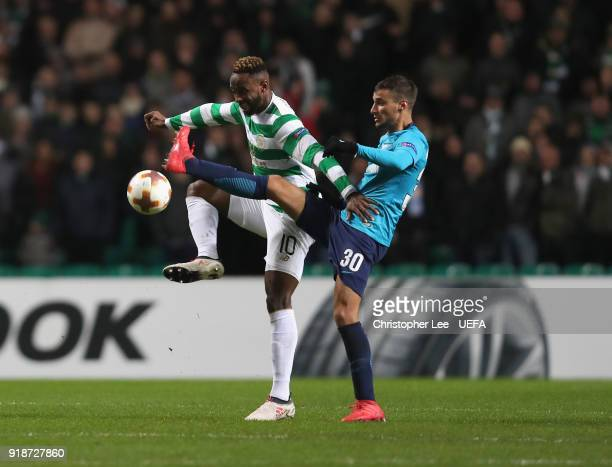 Moussa Dembele of Celtic battles with Emanuel Mammana of Zenit during UEFA Europa League Round of 32 match between Celtic and Zenit St Petersburg at...