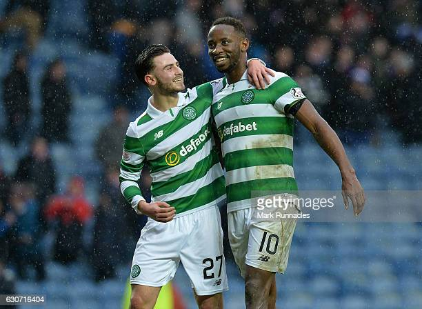 Moussa Dembele of Celtic celebrate at the final Whistle with team mate Patrick Roberts during the Scottish Premiership match between Rangers FC and...