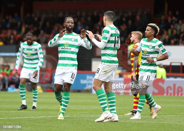 Moussa Dembele of Celtic is congratulated by team mates after he scores his team's second goal during the Betfred Scottish League Cup round of...