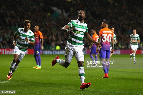 Moussa Dembele of Celtic celebrates after scoring his team's third goal during the UEFA Champions League group C match between Celtic FC and...