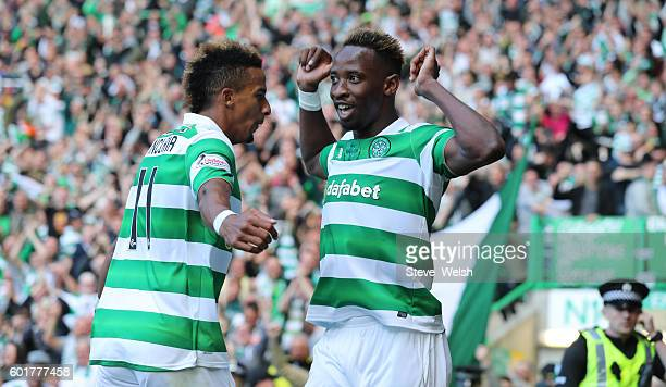 Moussa Dembele of Celtic celebrates his goal with Scott Sinclair Rangers during the Ladbrokes Scottish Premiership match between Celtic and Rangers...