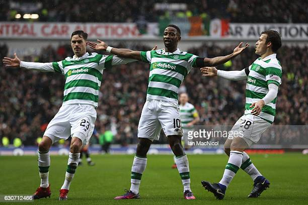 Moussa Dembele of Celtic celebrates scoring his team's first goal with his team mates Mikael Lustig and Erik Sviatchenko during the Ladbrokes...