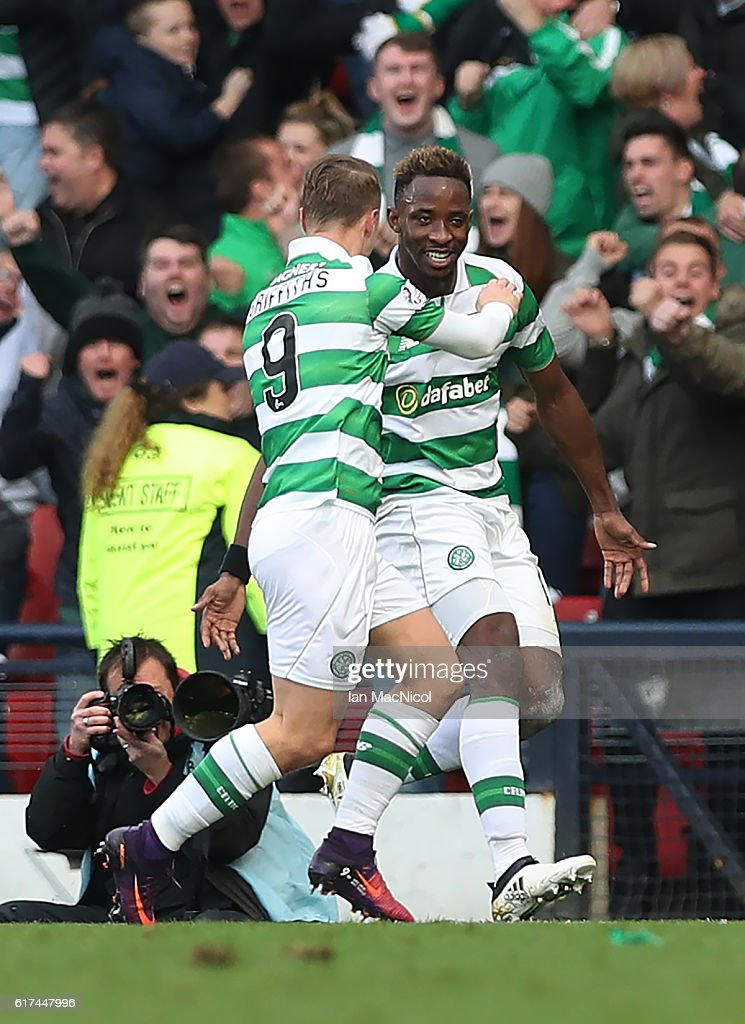 Moussa Dembele of Celtic celebrates with Leigh Griffiths of Celtic after he scores through the legs of Matt Gilks of Rangers during the Betfred Cup Semi Final match between Rangers and Celtic at Hampden Park on October 23, 2016 in Glasgow, Scotland.