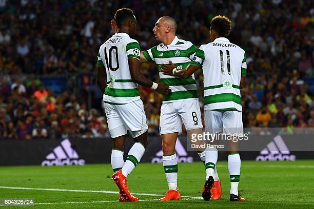 Moussa Dembele of Celtic celebrates with team mates Scott Brown of Celtic and Scott Sinclair of Celtic after winning a penalty during the UEFA...