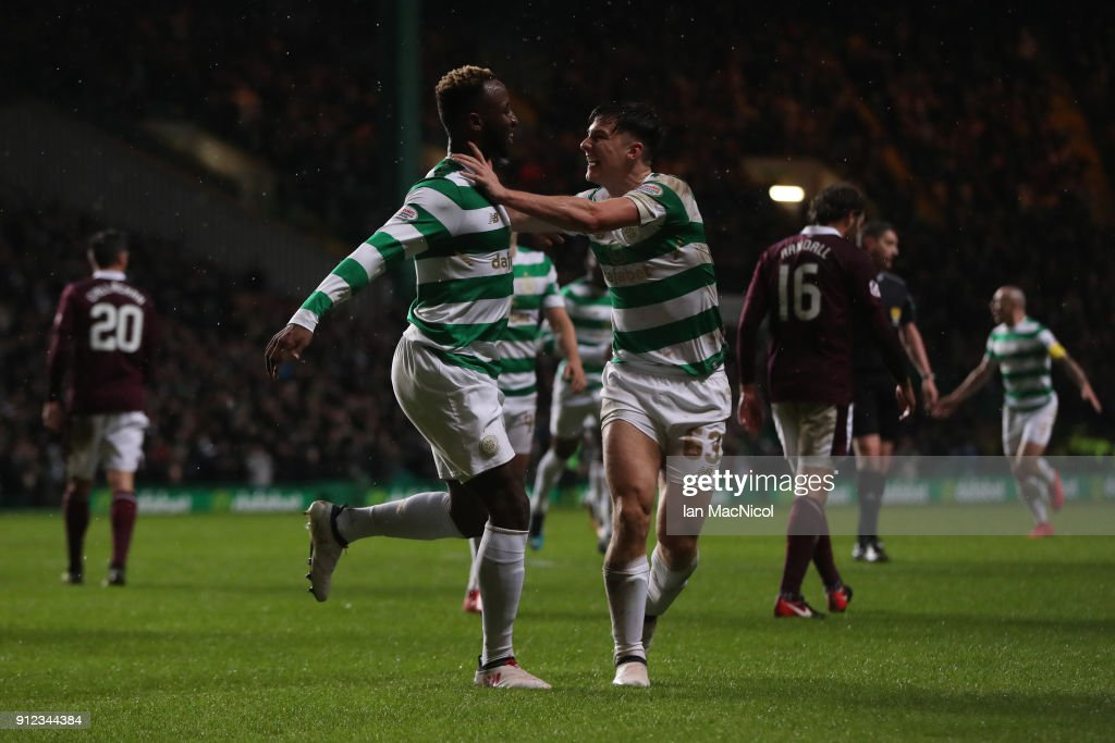 Moussa Dembele of Celtic celebrates with teammate Kieran Tierney after he scores his team's third goal during the Scottish Premier League match between Celtic and Heart of Midlothian at Celtic Park on January 30, 2018 in Glasgow, Scotland.