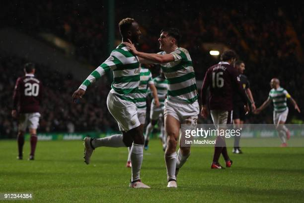 Moussa Dembele of Celtic celebrates with teammate Kieran Tierney after he scores his team's third goal during the Scottish Premier League match...
