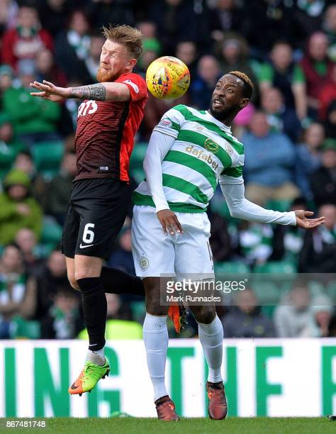 Moussa Dembele of Celtic challenges Alan Power of Kilmarnock for the ball during the Ladbrokes Scottish Premiership match between Celtic and...