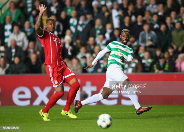 Moussa Dembele of Celtic FC crosses the ball past Jerome Boateng of Bayern Muenchen during the UEFA Champions League group B match between Celtic FC...