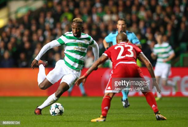 Moussa Dembele of Celtic FC takes on Arturo Vidal of Bayern Muenchen during the UEFA Champions League group B match between Celtic FC and Bayern...