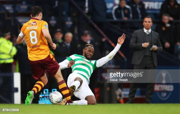 Moussa Dembele of Celtic goes in strong on Carl McHugh of Motherwell during the Betfred Cup Final at Hampden Park on November 26 2017 in Glasgow...