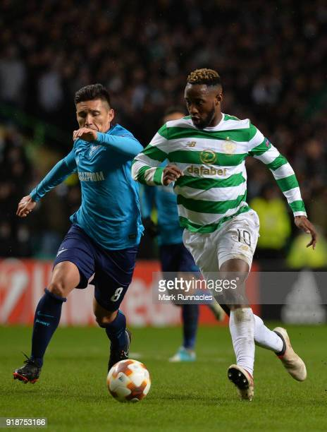 Moussa Dembele of Celtic is challenged by Matias Kranevitter of Zenit St Petersburg during UEFA Europa League Round of 32 match between Celtic and...