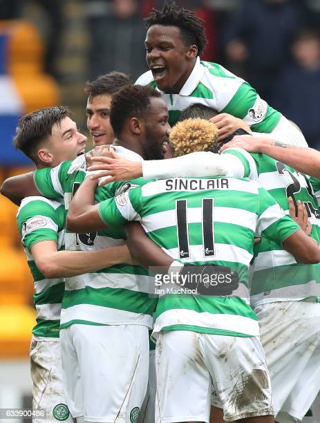 Moussa Dembele of Celtic is congratulated by team mates after he scores his third goal during the Ladbrokes Scottish Premiership match between St...