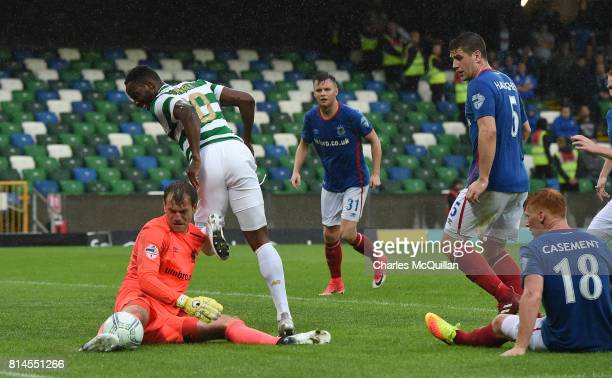Moussa Dembele of Celtic is denied by Roy Carroll of Linfield during the Champions League second round first leg qualifying game between Linfield and...