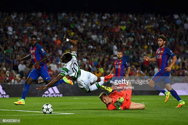 Moussa Dembele of Celtic is fouled by MarcAndre ter Stegen of Barcelona during the UEFA Champions League Group C match between FC Barcelona and...