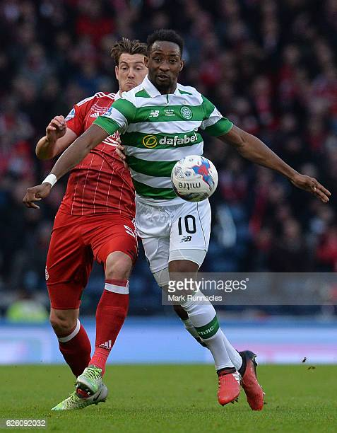 Moussa Dembele of Celtic is tackled by Ash Taylor of Aberdeen during the Betfred Cup Final between Aberdeen FC and Celtic FC at Hampden Park on...