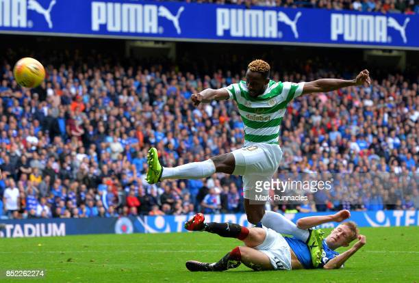 Moussa Dembele of Celtic is tackled by Ross McCrorie of Rangers during the Ladbrokes Scottish Premiership match between Rangers FC and Celtic FC at...