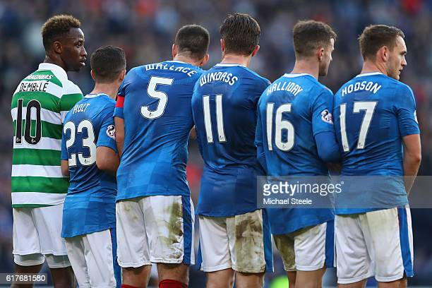 Moussa Dembele of Celtic lines up alongside Rangers players during the Betfred Cup SemiFinal match between Rangers and Celtic at Hampden Park on...