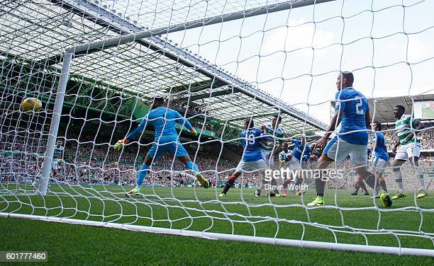 Moussa Dembele of Celtic scores his 1st goal during the Ladbrokes Scottish Premiership match between Celtic and Rangers on September 10 2016 in...