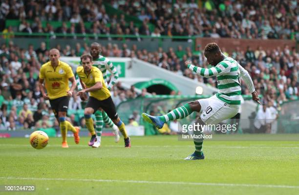 Moussa Dembele of Celtic scores his second goal from the penalty spot during the UEFA Champions League Qualifier between Celtic and Alashkert FC at...